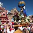 Постер, плакат: Unknown people participate in the Godfather to the course on a religious holiday in Cuzco Peru