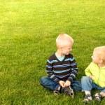 Happy children on green grass — Stock Photo #71707307