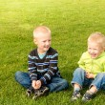 Happy children on green grass — Stock Photo #71707309