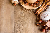 Sweets and spices on wooden background — Stock Photo