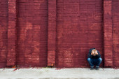 Depressed child and brick wall — Stock Photo