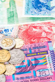 Hong Kong dollar money banknote close-up with coins — Stock Photo