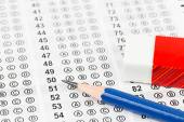Blanked answer sheet with eraser focus on pencil — Stock Photo