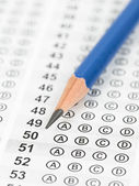 Blanked answer sheet focus on pencil — Stock Photo