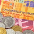 Switzerland money swiss franc banknote and coins close-up — Stock Photo #58636529