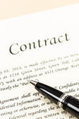 Business contract document on cream color paper focus at pen — Stock Photo