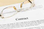 Business contract document with glasses — Stockfoto