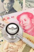 Stethoscope on asian banknote concept financial health check — Stock Photo