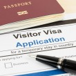 Visa application form with passport and pen — Stock Photo #58645161