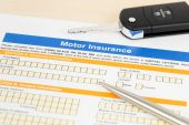 Motor or car insurance application with pen and car key — Stock Photo
