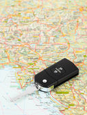 Car key on street map travel concept — Stock Photo