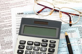 Tax form with pen, calculator, and glasses taxation concept — Stock Photo