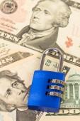 Combination padlock on dollar banknote — Stock Photo