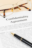 Confidentiality agreement document with glasses close-up — Stock Photo