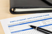 Employment application form with pen and organizer concept job a — Stock Photo