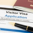 Visa application form with passport and pen — Stock Photo #64422813
