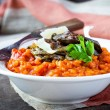 Tomato risotto, red rice with fried chicken liver, onions, Itali — Stock Photo #67790403