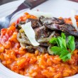 Tomato risotto, red rice with fried chicken liver, onions, Itali — Stock Photo #67790413