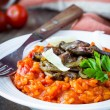 Tomato risotto, red rice with fried chicken liver, onions, Itali — Stock Photo #67790423