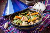Oriental stew with meat, vegetables, green beans, carrot in tagi — Stock Photo