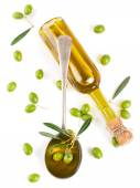 View from above of a olive oil in bottle, in a spoon and raw oli — Stock Photo