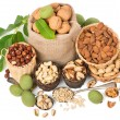 mixed nuts with leaves of walnut, top view  — Stock Photo #53409753