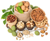 mixed nuts with leaves of walnut, top view  — Stock Photo