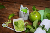Green apple and spa item — Stock Photo