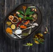 Various spices, olives and olive oil, top view — Stock Photo