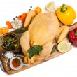 View from above of whole raw chicken ready to roast with cooking — Stock Photo #60537371