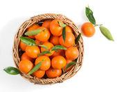 Mandarin in a wicker basket — Stock Photo