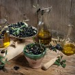 Постер, плакат: Balance scale fresh olives and olive oil