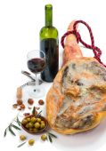 Ham, olives, wine and nuts — Stock Photo