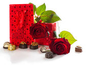 Gift, chocolates and roses — Stock Photo