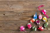 Top view of easter eggs decorated bows — Stock Photo