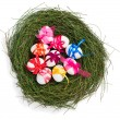 Colorful easter eggs in a nest, top view — Stock Photo #64463871
