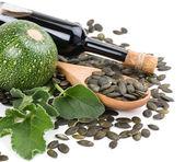 Glass bottle of Pumpkin Seed Oil, pumkin and peeled pumpkin see — Stock Photo