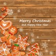 Christmas greeting card with gingerbread cookies — Vector de stock  #59105515