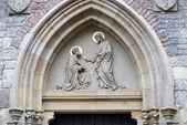 Sculpture above entrance of St. Peter Church Na Porici, Prague. — Stock Photo