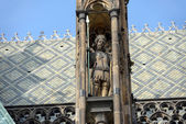 Sculpture in pinnacle of buttress of cathedral St. Vitus, Prague — Stock Photo