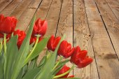 Tulips on the background of wooden planks — Stock Photo