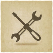 Screw driver and wrench symbol old background — Stock Vector