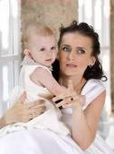 Young woman holding a child at the hands — Stock Photo