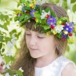 Girl in a flower wreath holds a branch of Apple — Stock Photo #75204829