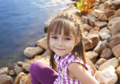 Smiling girl by the pond — Stock Photo