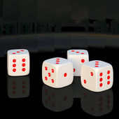 White dice on a black background. — Stock Photo