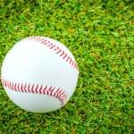 Baseball on green grass — Stock Photo #51855877
