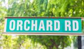 """Street sign that read """" Orchard Road""""  — Stock Photo"""