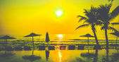 Silhouette pool beach and palm tree sunset times — Stock Photo