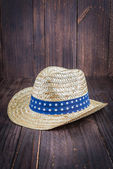 Beach hat on wooden background — Stock Photo
